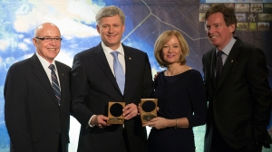 Prime Minister Stephen Harper and his wife Laureen receive the Erebus Medal from John Geiger, CEO of The Royal Canadian Geographical Society, and Dr. Paul Ruest, President of The Royal Canadian Geographical Society, for their contributions to and support for the 2014 Victoria Strait Expedition which led to the discovery of HMS Erebus during an event at the Royal Ontario
