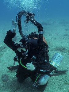 Archaeologist in mixed gas rig. Not the easiest way to wield a trowel. Photo: WHOI