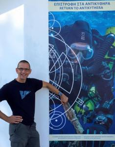 Phil Short and Antikythera poster. Photo: WHOI